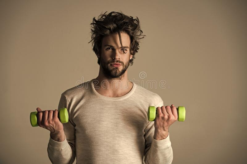 Mens heals care. Athlete in underwear training with barbell. royalty free stock photography