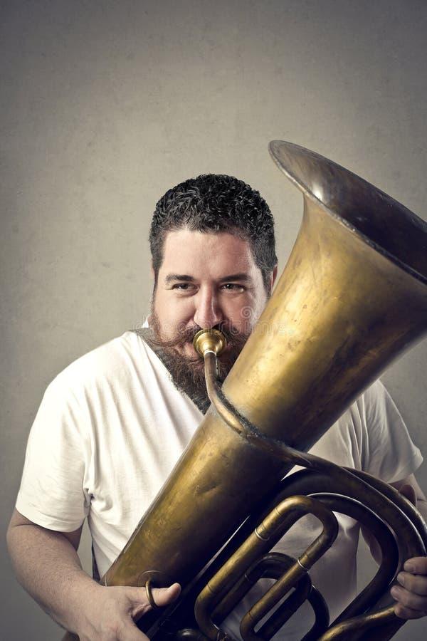 Mens het Spelen Trombone stock foto