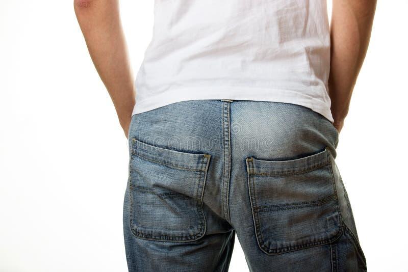 Mens in jeans in rug royalty-vrije stock afbeeldingen