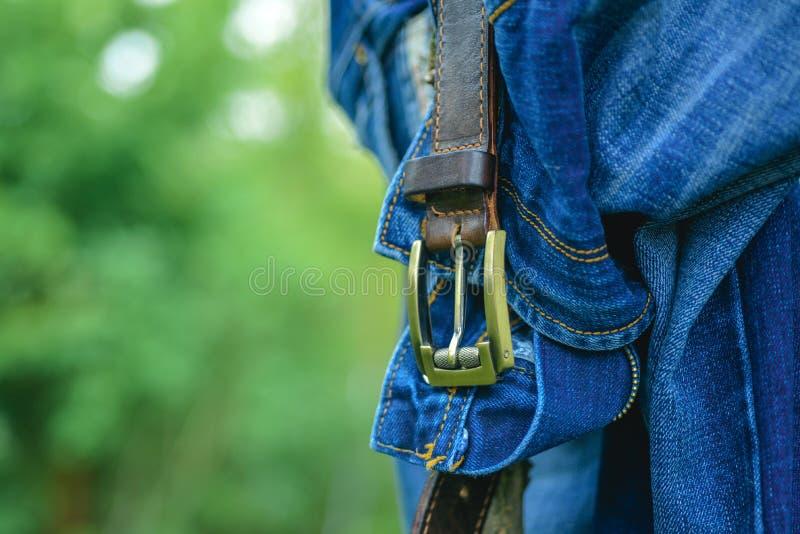 Mens Jeans shop. Young fashion man`s jeans. Denim concept. Fashion belt. stock photo
