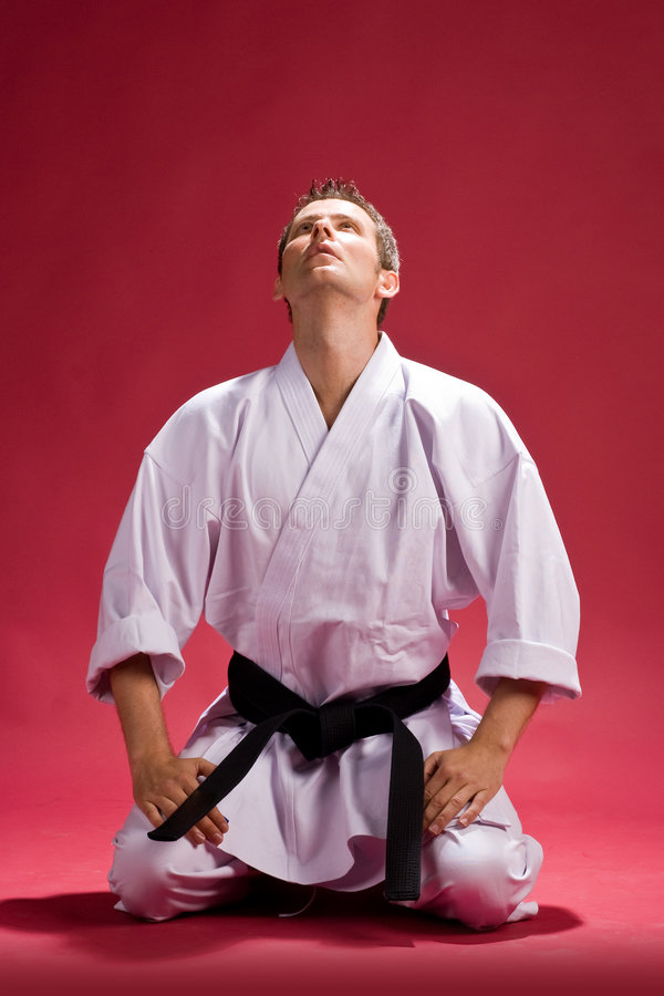 Mens in karatekimono royalty-vrije stock foto
