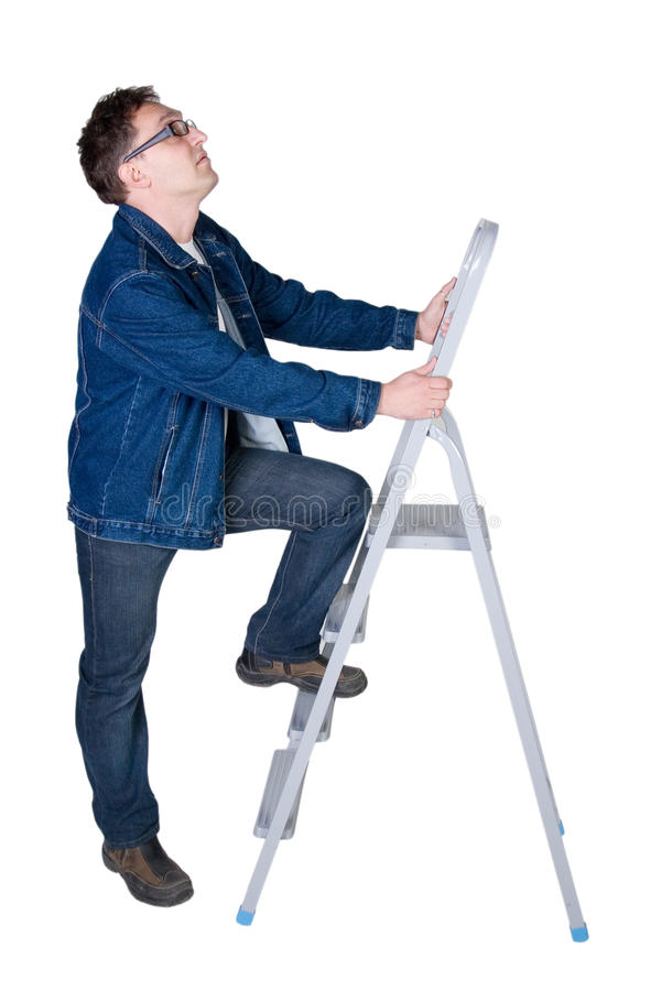 Mens klaar om een ladder te beklimmen royalty-vrije stock afbeeldingen