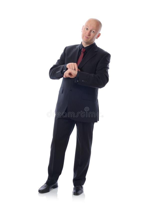 Mens in kostuumtijd stock afbeeldingen