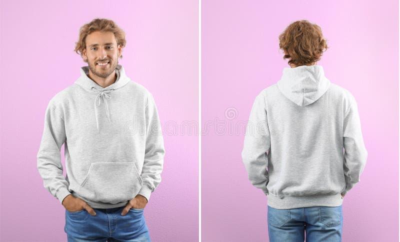 Mens in lege hoodiesweater op kleurenmeningen als achtergrond, voor en achter stock afbeeldingen
