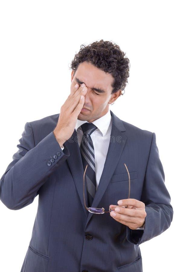 Mens met de glazen van een hoofdpijnholding stock afbeeldingen