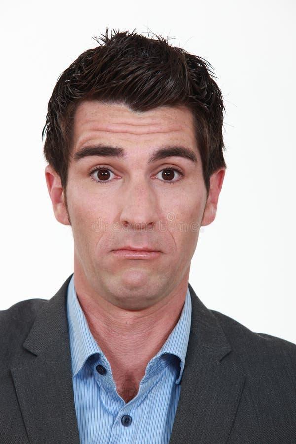 Mens met een bizar gezicht. stock foto