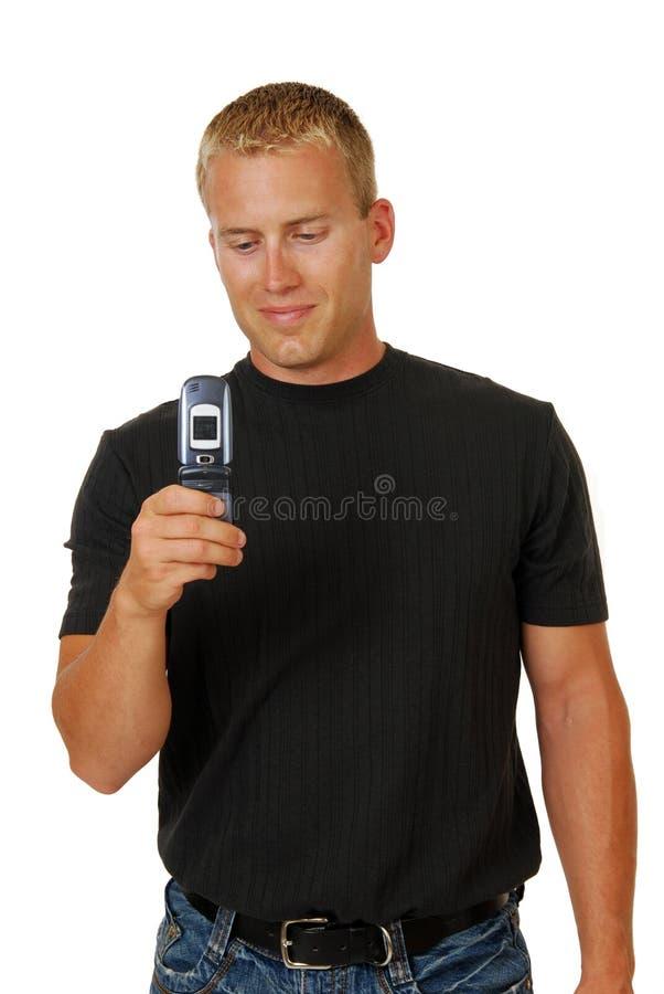 Mens met een celtelefoon royalty-vrije stock fotografie