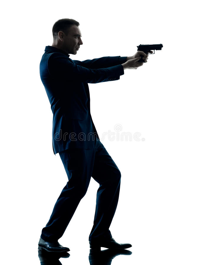 Mens met een geïsoleerd pistoolsilhouet stock fotografie