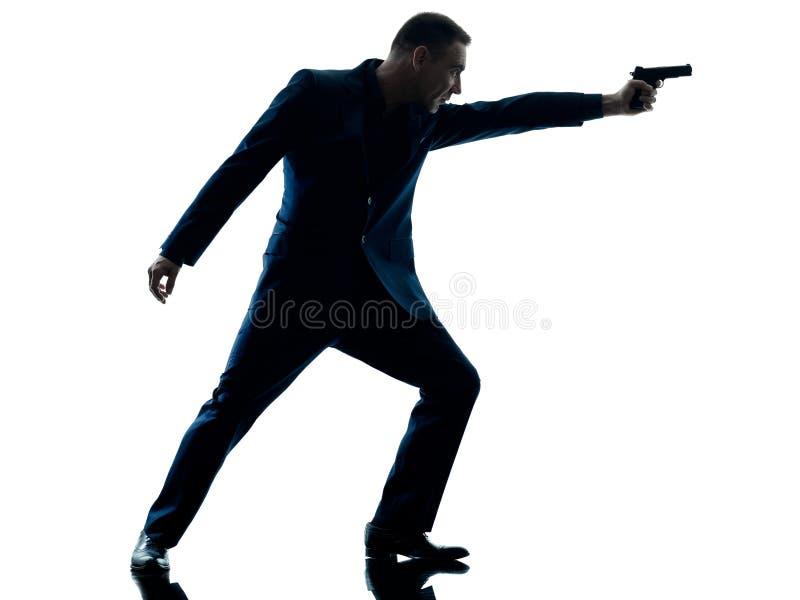 Mens met een geïsoleerd pistoolsilhouet royalty-vrije stock afbeeldingen