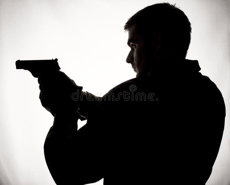Mens met een kanon stock foto