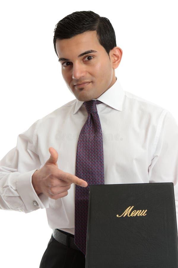 Mens met een menu of ander boek royalty-vrije stock afbeelding