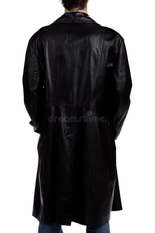 Mens met een zwarte overjas stock afbeeldingen