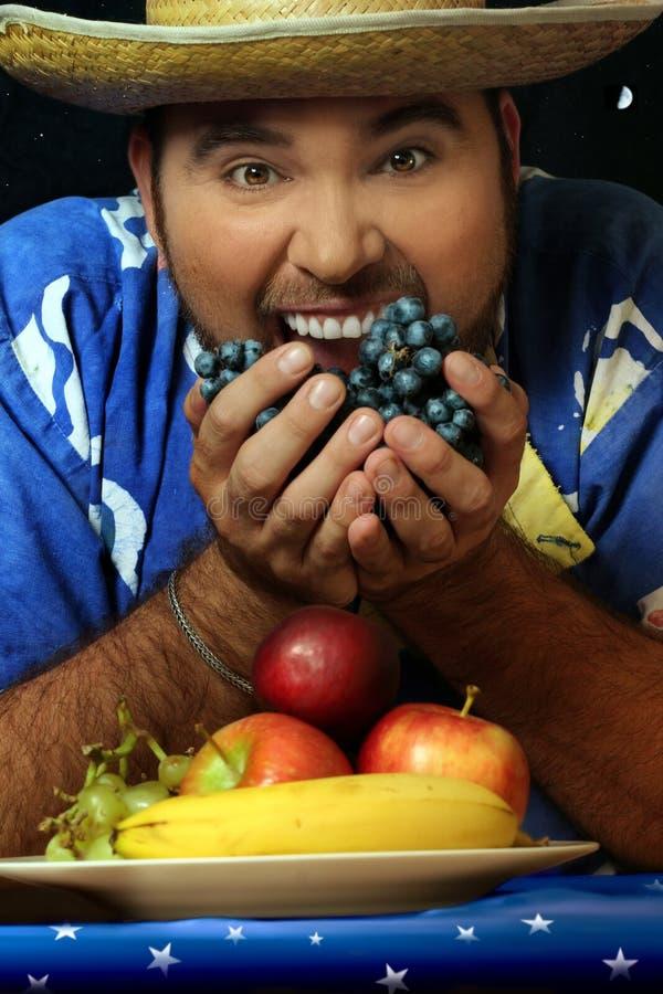 Mens met fruit stock foto
