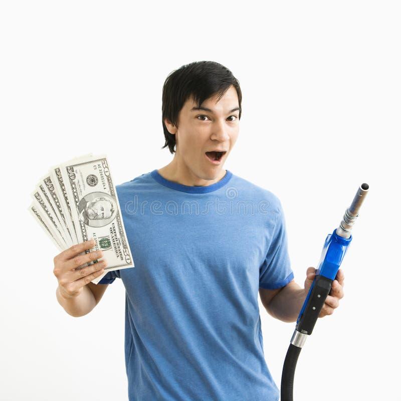 Mens met geld en gaspijp. stock afbeeldingen