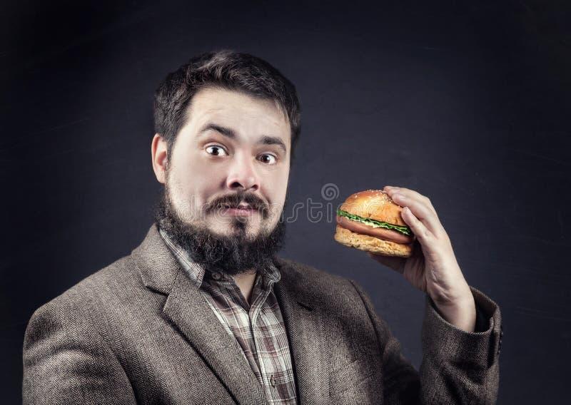 Mens met hamburger royalty-vrije stock afbeelding