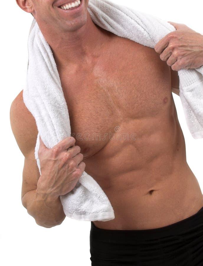 Mens met handdoek stock fotografie