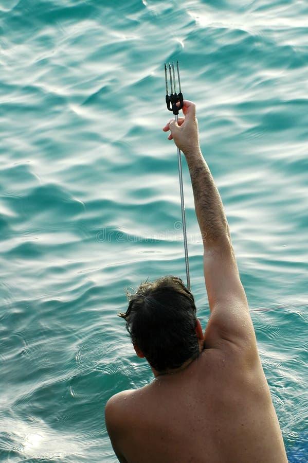 Mens met harpoen royalty-vrije stock fotografie
