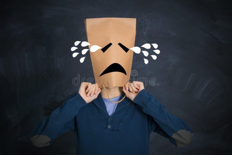 Mens met het droevige uitdrukking schreeuwen stock foto
