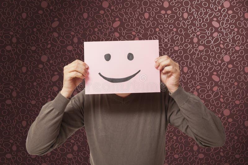 Mens met het grappige gezicht glimlachen stock foto's