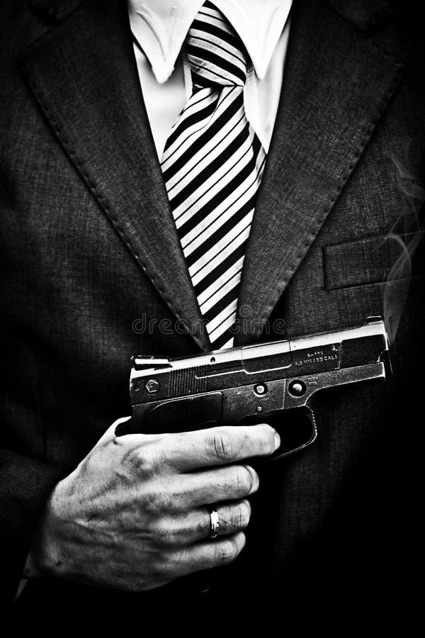 Mens met het wapen stock foto's