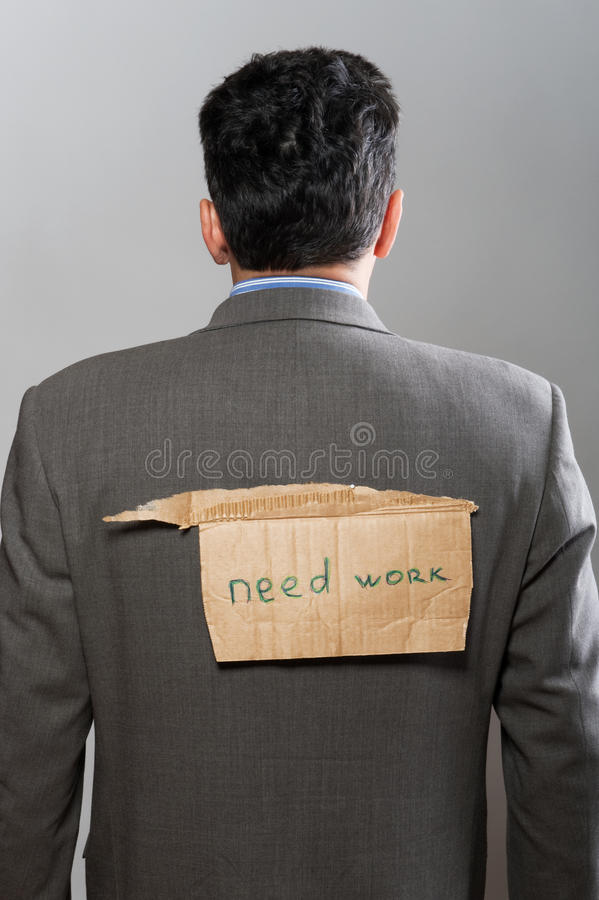 Mens met het Werk van de Behoefte van het kartonteken stock foto's