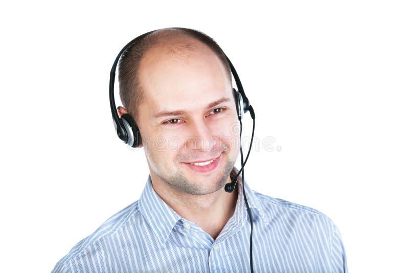 Mens met hoofdtelefoon met een boommicrofoon stock foto's