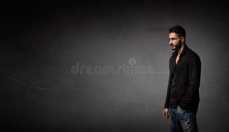 Mens met jasje in een profielmening stock fotografie