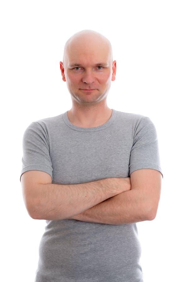 Mens met kaal hoofd in grijs overhemd stock afbeelding