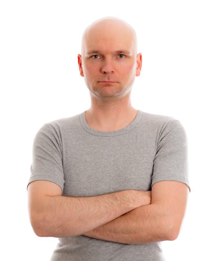 Mens met kaal hoofd in grijs overhemd royalty-vrije stock foto