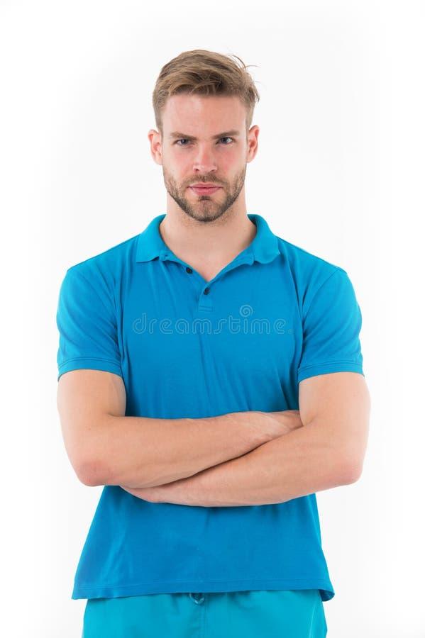 Mens met in kapsel en klein die varkenshaar op witte achtergrond wordt geïsoleerd Sportman in blauwe uitrusting bij de opleiding, stock afbeelding
