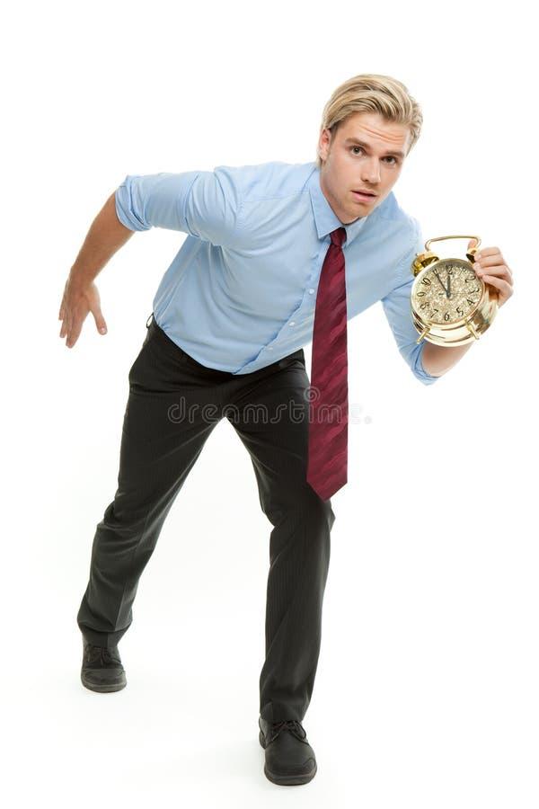 Mens met klok stock afbeelding