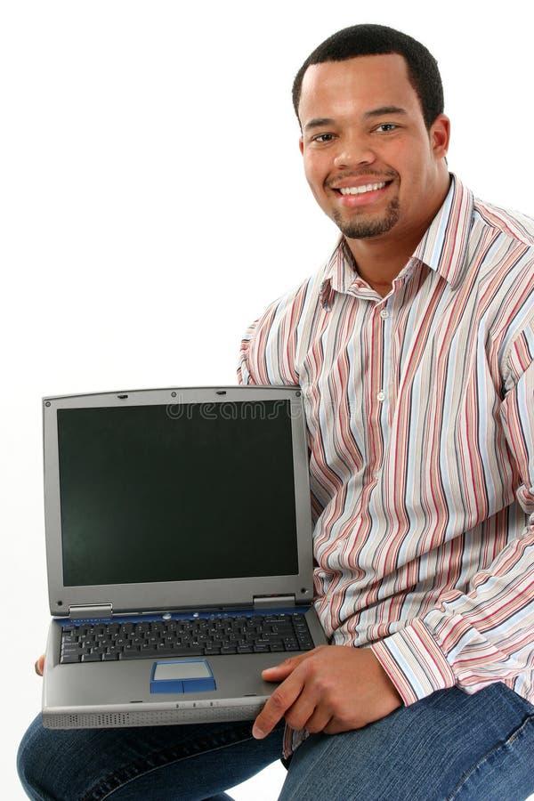 Mens met laptop stock foto's
