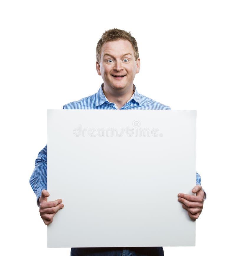 Mens met lege tekenraad stock afbeeldingen