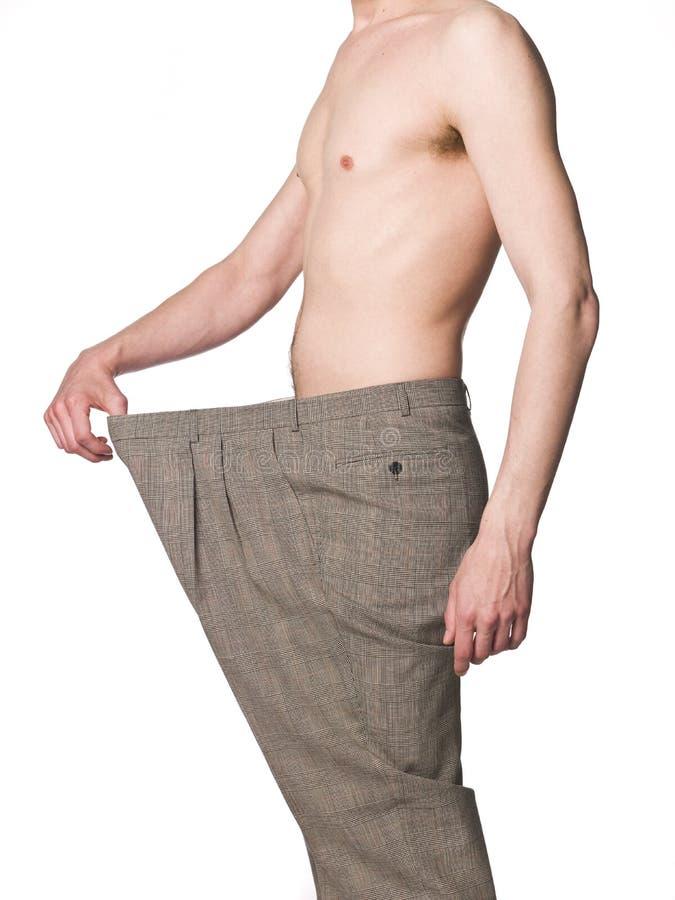 Mens met overmaatse broeken stock foto
