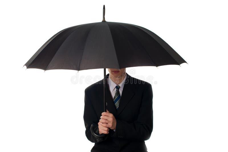 Mens met paraplu stock afbeelding