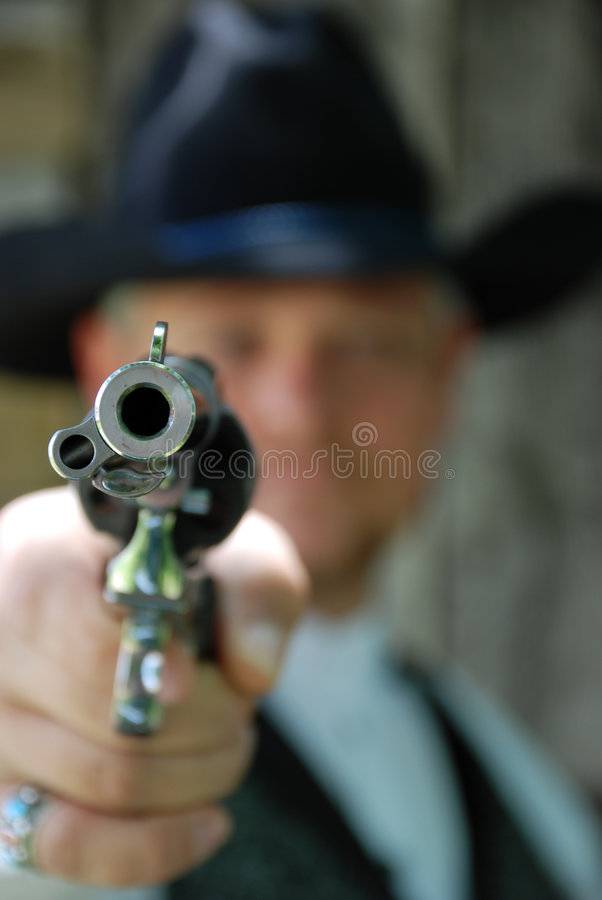 Mens met pistool stock foto's