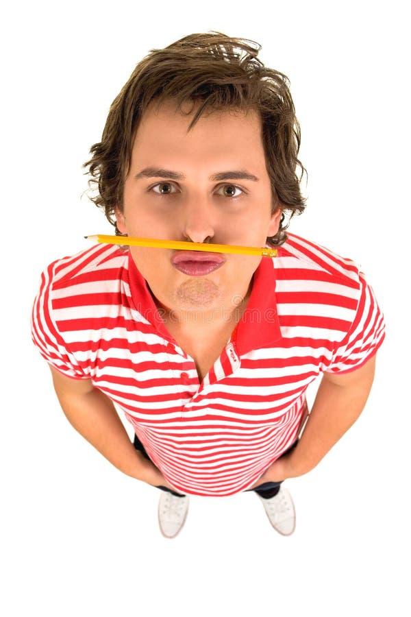 Mens met potlood onder zijn neus stock afbeeldingen