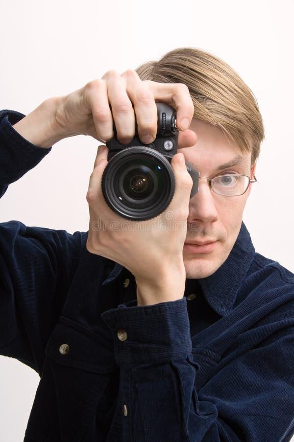 Mens met reflexcamera royalty-vrije stock fotografie