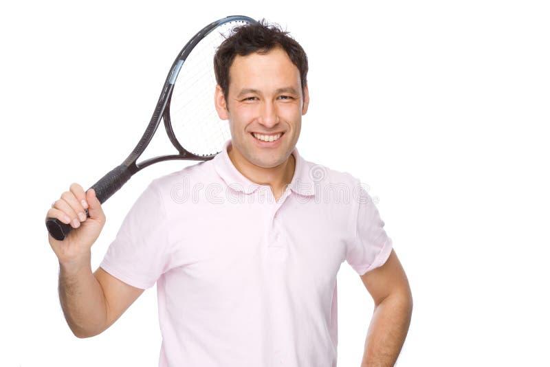 Mens met tennisracket stock fotografie