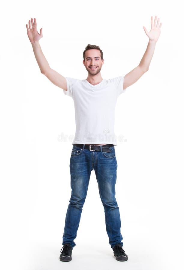 Mens met in toevallig met opgeheven handen omhoog geïsoleerd stock foto's