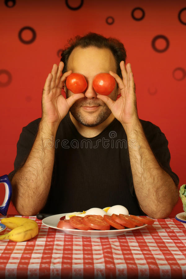 Mens met tomaten royalty-vrije stock foto