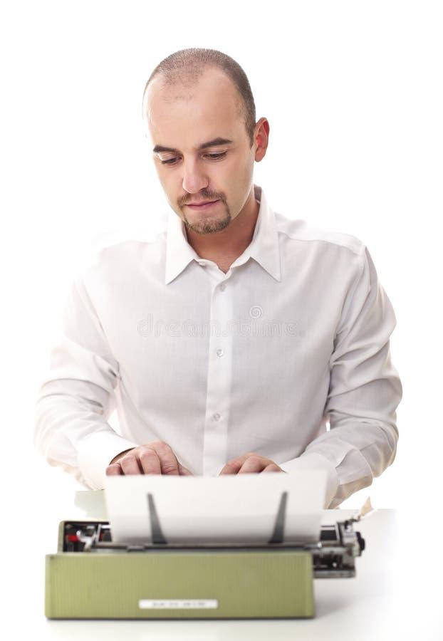Mens met uitstekende schrijfmachine royalty-vrije stock afbeelding