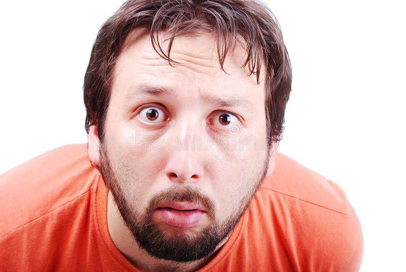Mens met verraste uitdrukking op gezicht stock afbeelding