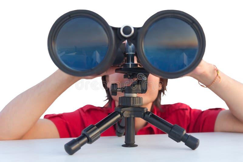 Mens met verrekijkers die op wit wordt geïsoleerde stock fotografie
