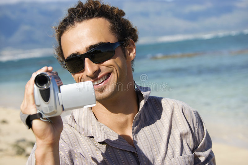 Mens met videocamera. royalty-vrije stock afbeelding