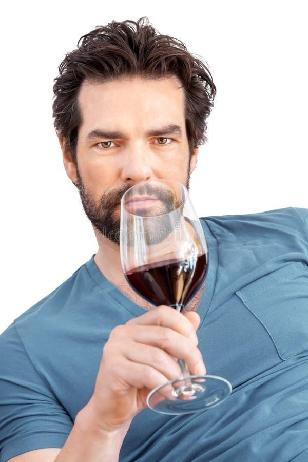 Mens met wijnglas stock foto
