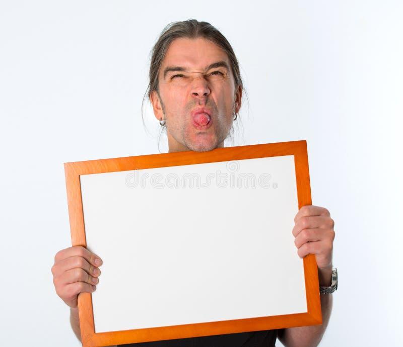 Mens met wit uithangbord stock afbeelding