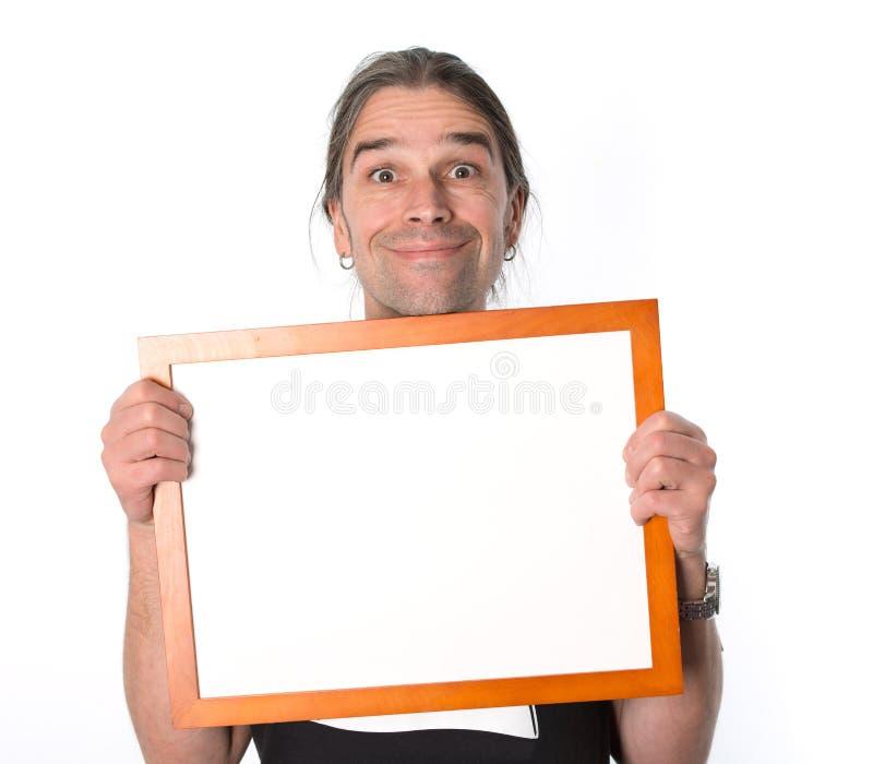 Mens met wit uithangbord stock foto