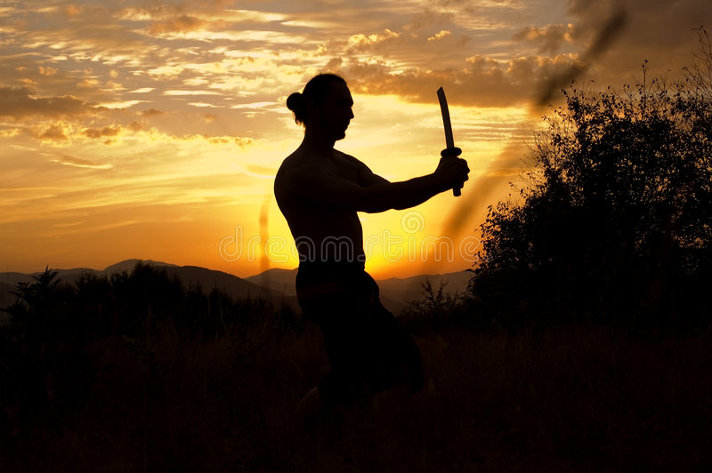 Mens met zwaard royalty-vrije stock afbeelding