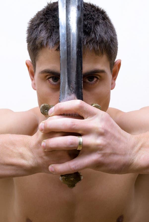 Mens met zwaard royalty-vrije stock foto